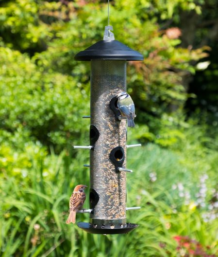 giant seed feeder showing wild birds feeding from it