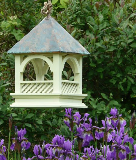 A hanging Bempton Bird Table shown in the garden