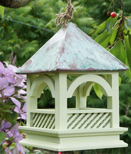 A hanging Bempton Bird Table close up in the garden